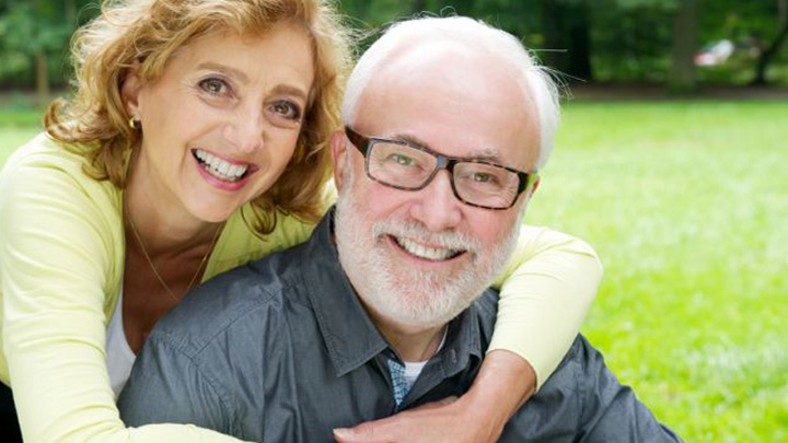 Happy-retired-senior-couple-smiling-in-the-park