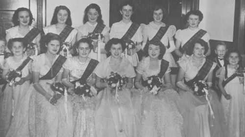 StateLibQld_1_296739_Debutantes_holding_bouquets_at_a_social_dance,_1952