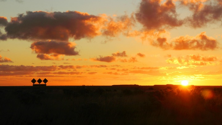 A golden sunset along the road in the Nullarbor.