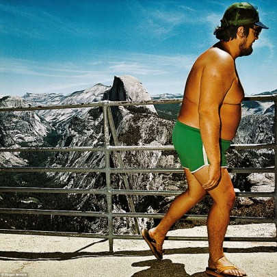 Lots of collection feature bare-chested men, such as this image of a tourist at Glacier Point in Yosemite National Park in California in 1980.