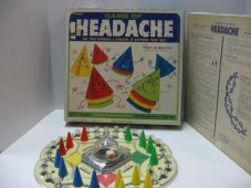 First introduced in the late-'60s, Headache uses a round board and its dice was in a bubble at the centre of the board. The whole object of this game was to stack as many of your cones on the tops of your opponent's cones in order to be declared the winner.