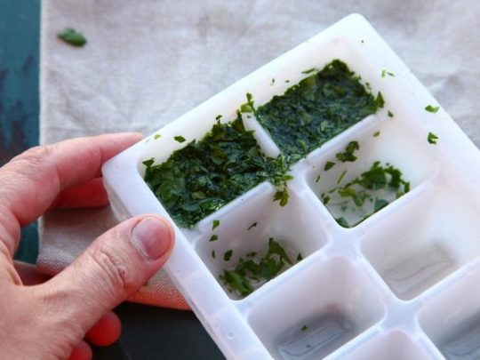 Chop the herbs up, stuff them into the ice trays and soak with olive oil. Store in the freezer until you need to use them.