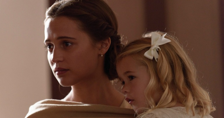 Isabel (Alicia Vikander) and Lucy-Grace (Florence Clery) in a scene from The Light Between Oceans.