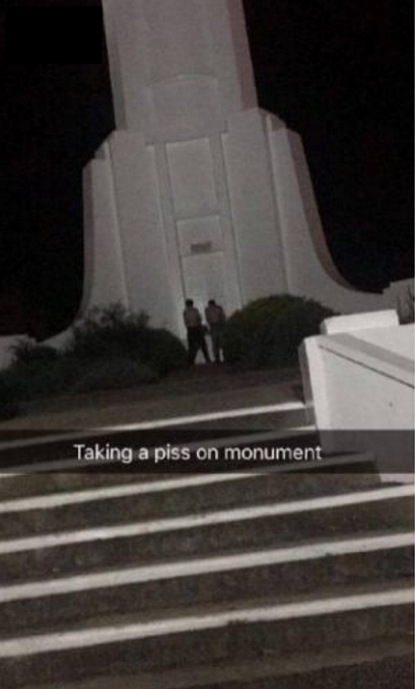 Two men were pictured urinating against the war memorial.