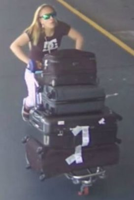 She was seen pushing bags out of the airport.