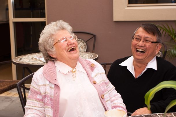 Choe Lam Tan has a laugh with one of the residents at Jeta Gardens.