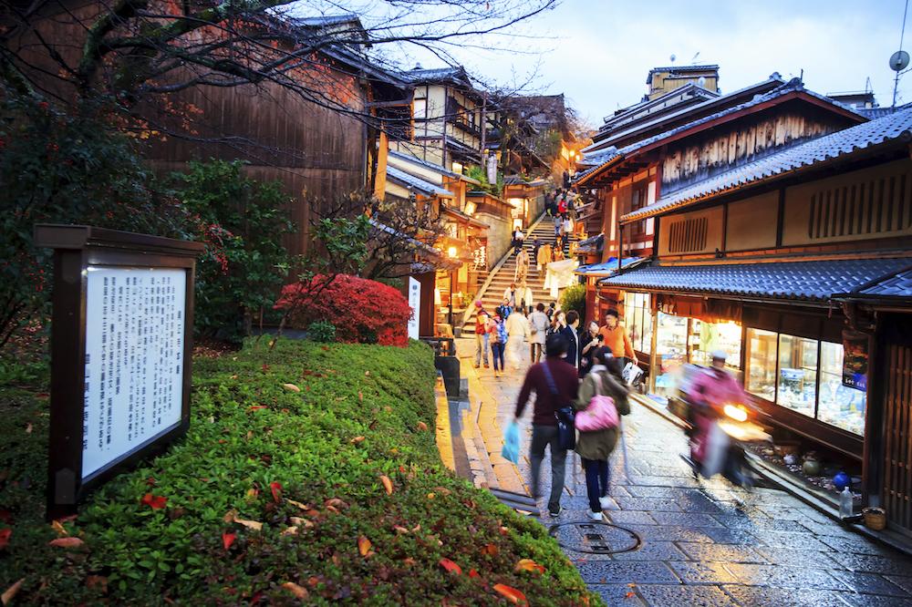 Tourists walk on a street leading to Kiyomizu Temple
