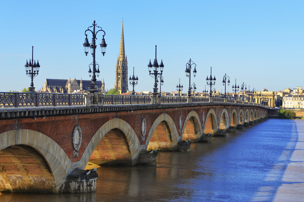 Bordeaux river bridge with St Michel cathedral in background