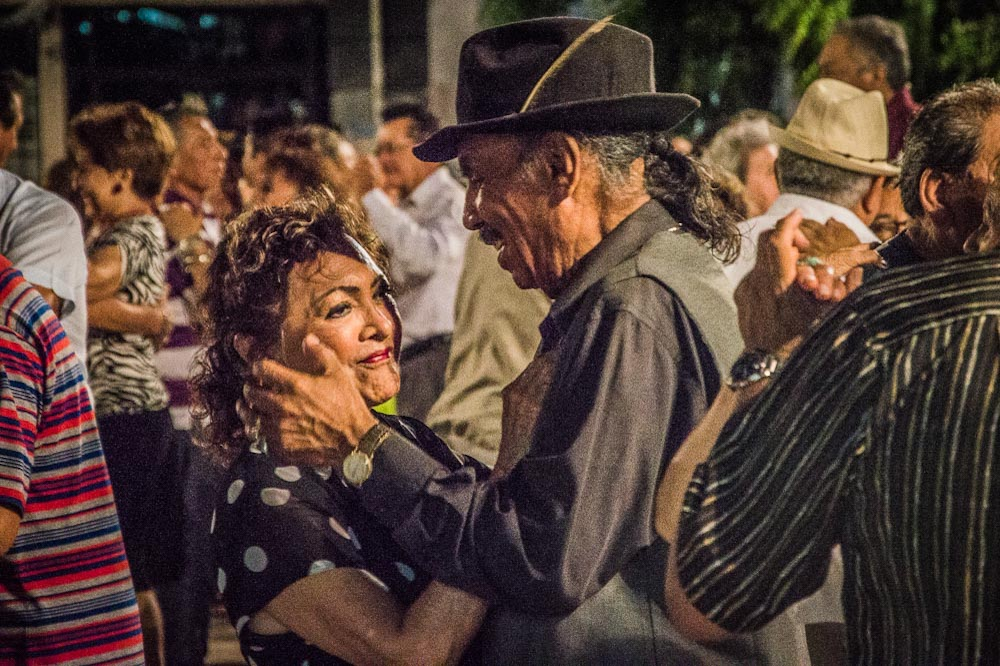 A couple enjoys the moment, dancing in the squares in Merida