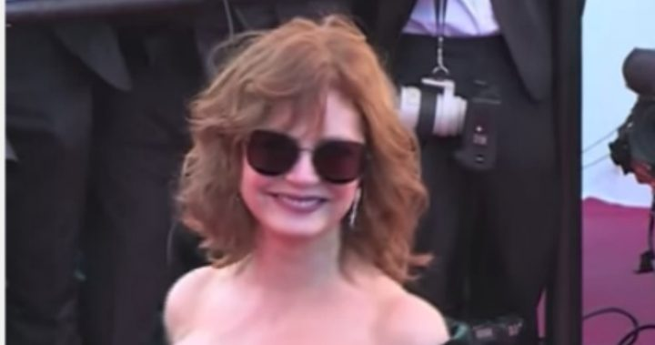 Headshot of Susan Sarandon on red carpet wearing sunglasses
