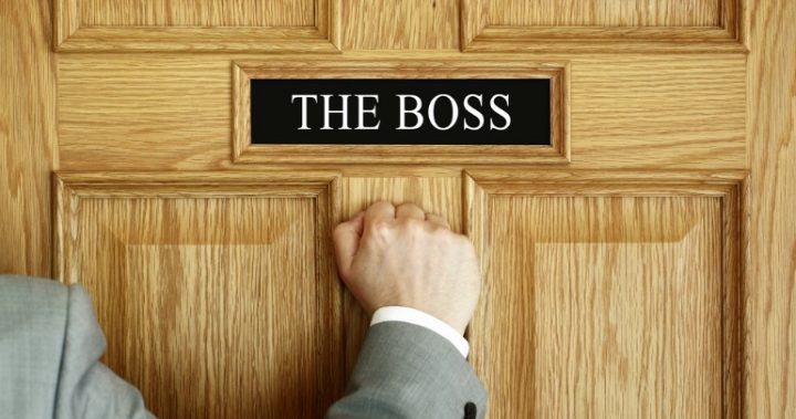 man knocking on boss's door