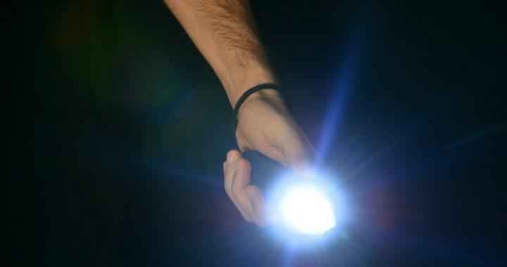 man holding torch