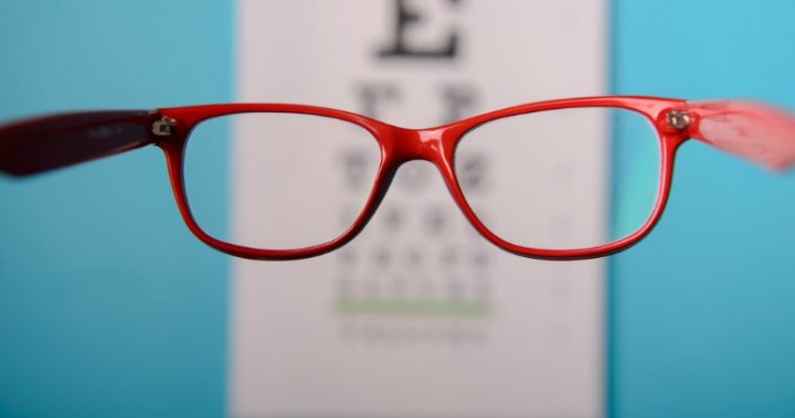 red glasses looking at eye test