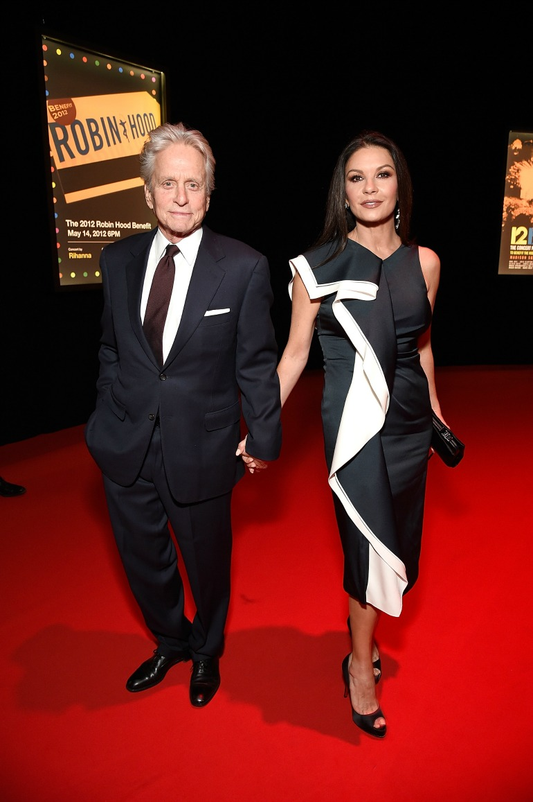 Michael Douglas and Catherine Zeta-Jones held hands as they posed for photos. Source: Getty