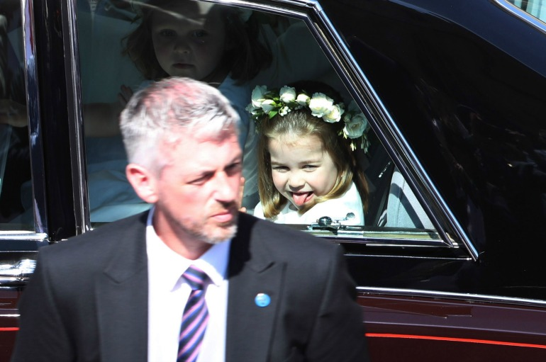 The young royal cheekily stuck out her tongue as she pulled up to the church. Source Getty