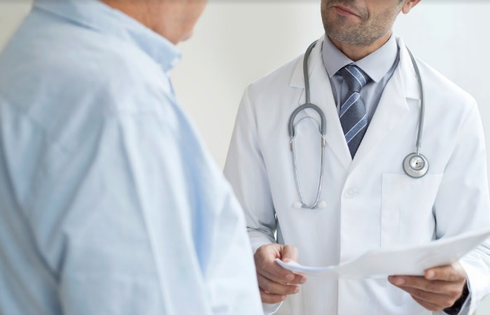 man with asthma visits doctor