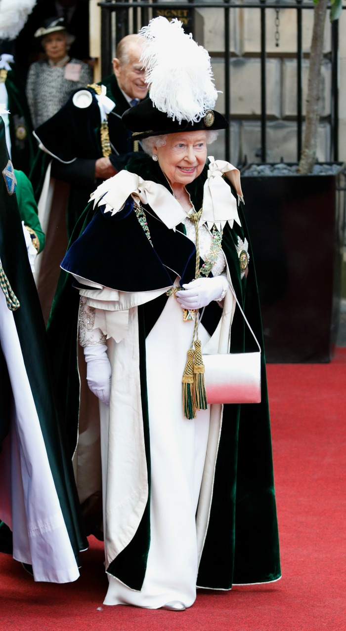 The Queen flashed a smile despite the searing heat. Source: Getty.