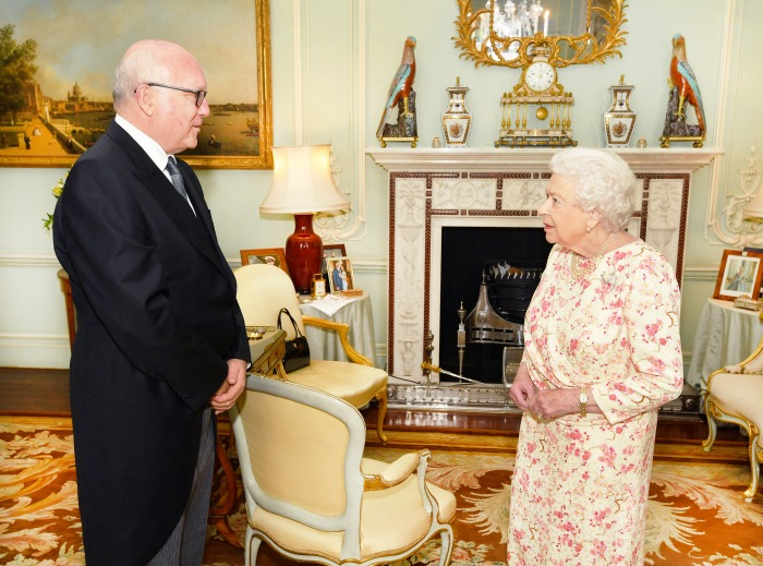 The Queen proudly displayed a photo of Meghan and Harry at Buckingham Palace.