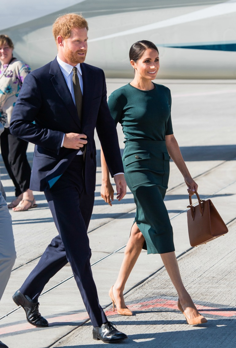 The duchess touched down in Dublin with Prince Harry wearing a green Givenchy pencil skirt. Source: Getty