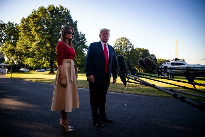Melania Trump dressed in a stunning beige and red outfit as she left to White House on route to Brussels. Source: Getty
