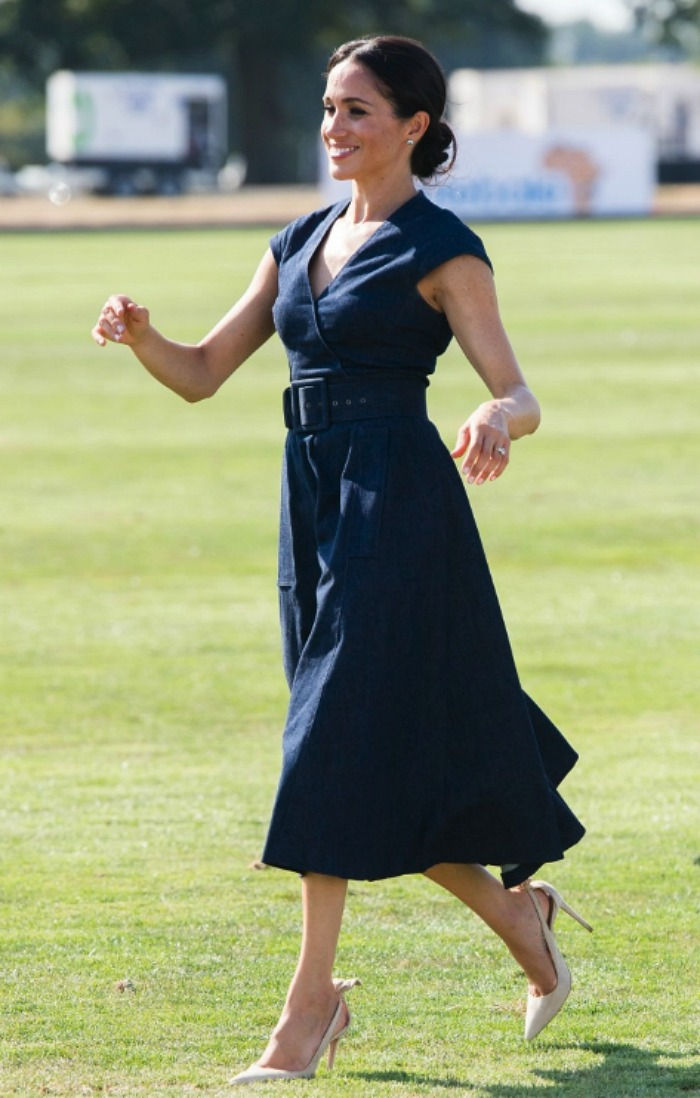 Meghan stunned in a '50s style navy dress. Source: Getty.