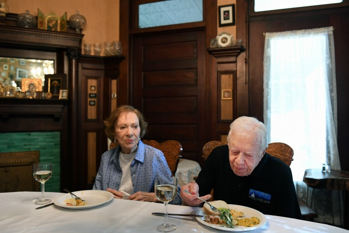 Jimmy Carter sits next to his wife, former First Lady Rosalynn Carter.