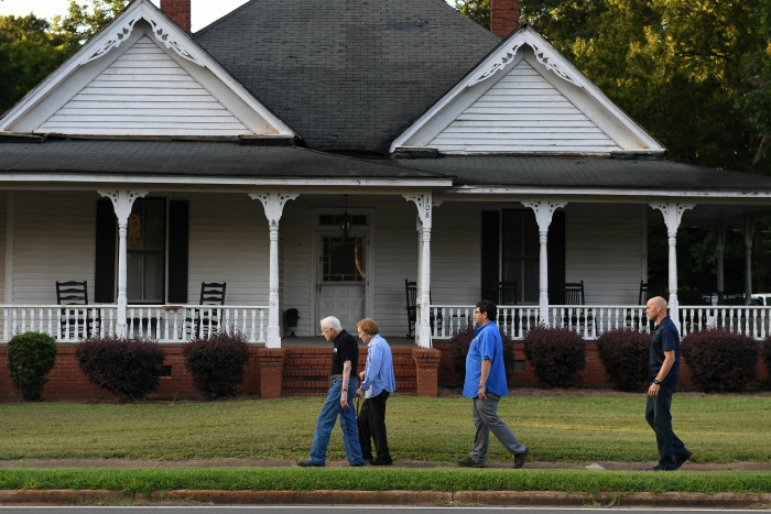 Jimmy Carter walks with his wife in their hometown.