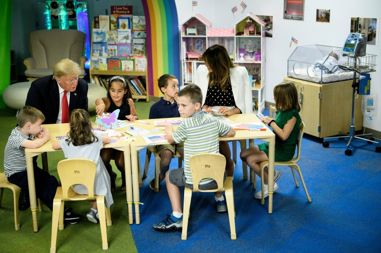 Donald Trump colours in the American flag wrong at children's hospital