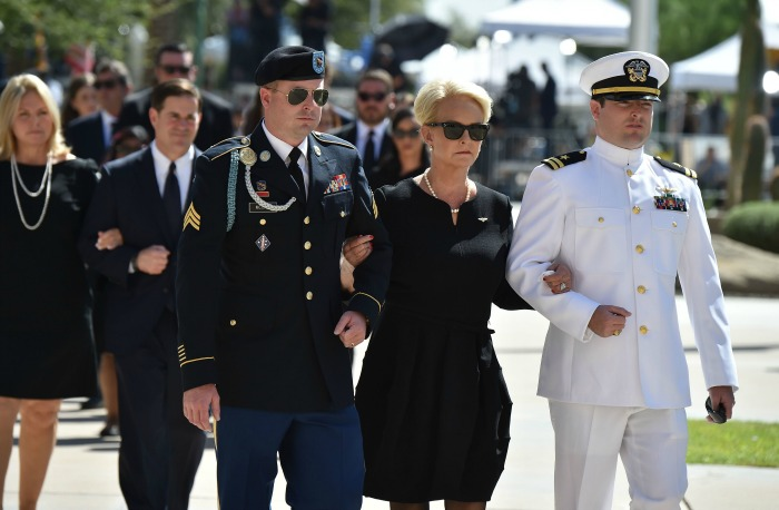 Cindy McCain was supported by her sons at the service. Source: Getty.