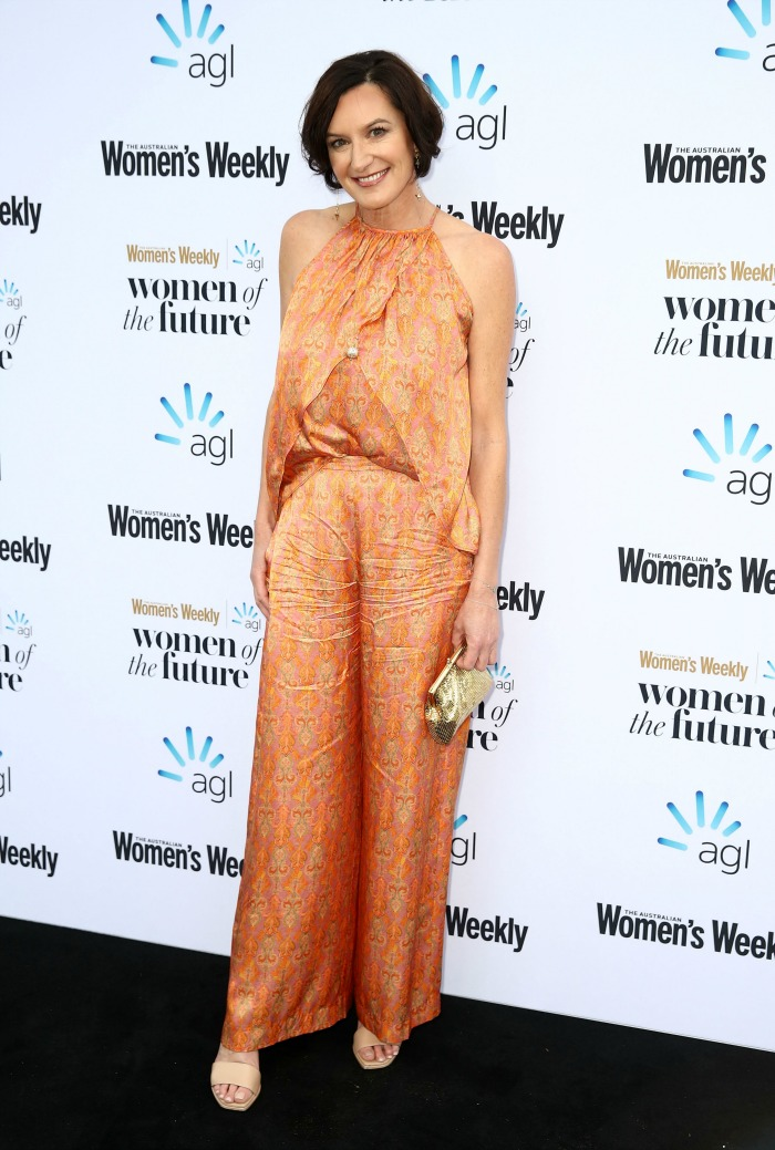 Cassandra Thorburn stunned in a bright orange jumpsuit. Source: Getty.