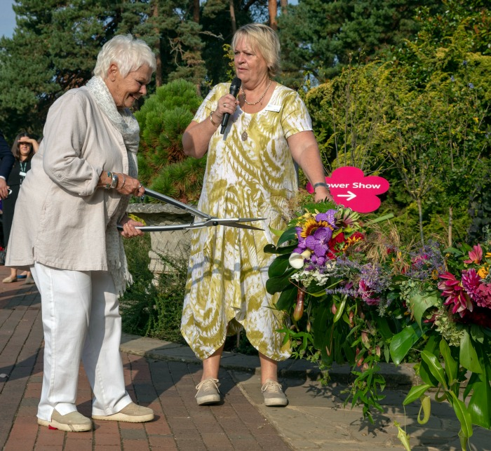 Judi Dench wasn't afraid to get her hands dirty at the RHS Garden Wisley Flower Show.