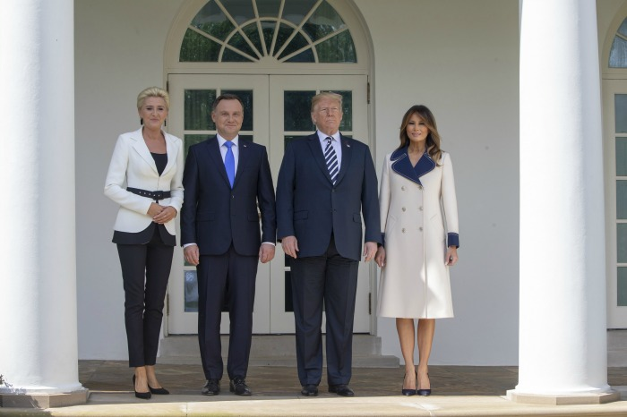 Melania Trump looked stunning in a long cream coat as she met with Polish President Andrzej Sebastian Duda and his wife Agata Kornhauser alongside husband President Donald Trump.
