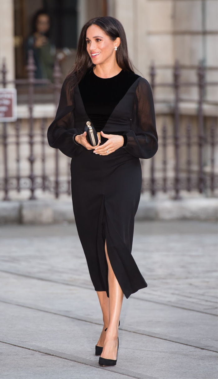 The Duchess of Sussex glowed in a stunning black frock as she stepped out solo for the Royal Academy Oceania Exhibition in London on Tuesday.