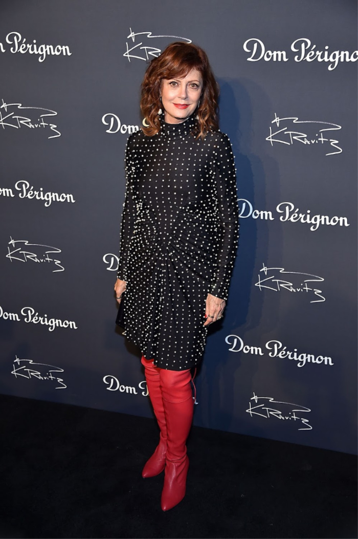 Susan Sarandon looked fabulous as she stepped out in knee-high red boots to an exhibition in New York City.