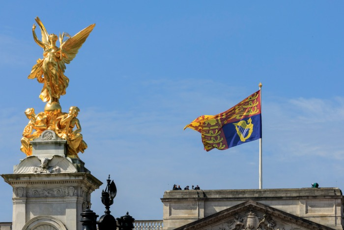 Seeing the Royal Standard flag flying above the palace means the Queen is home. Source: Getty.
