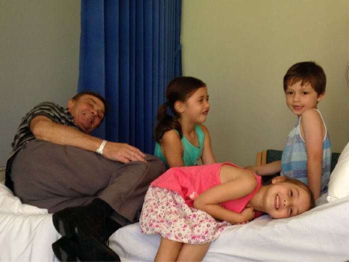 Gerald pictured during a stay in hospital, with Sonny, Saffron and Scarlett keeping him entertained. Source: Supplied.