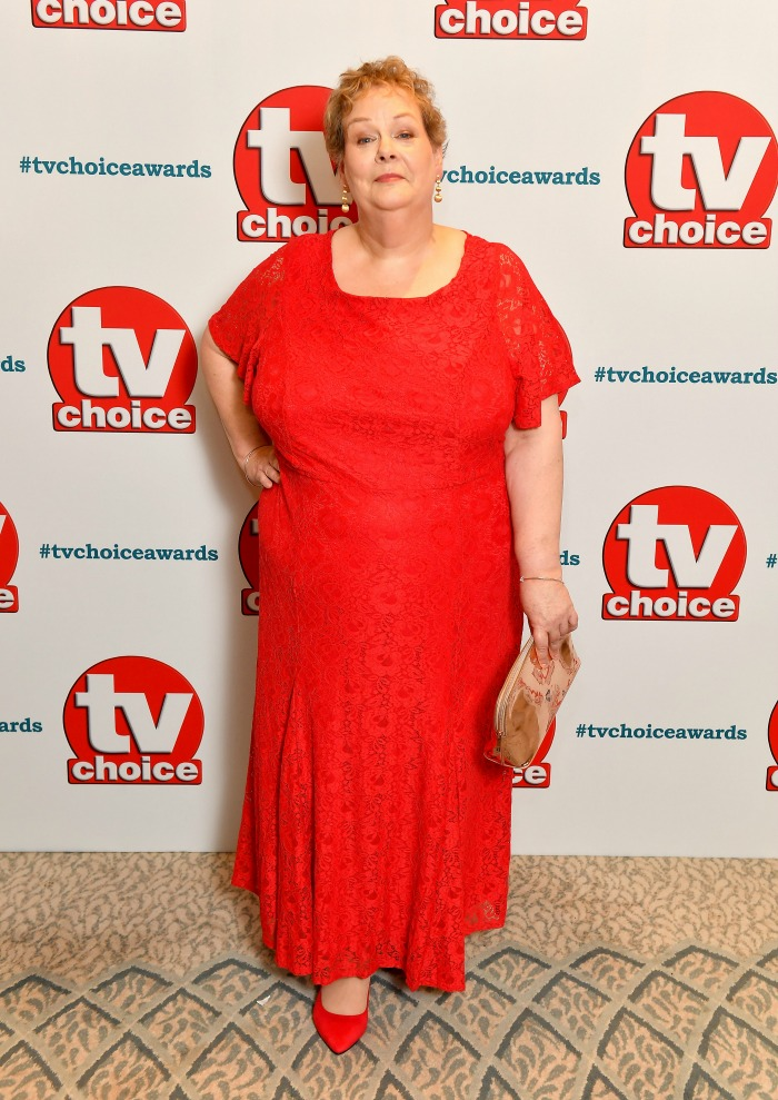 Anne Hegerty looked stunning as she stepped out in a vibrant red dress for the TV Choice Awards in London in September.