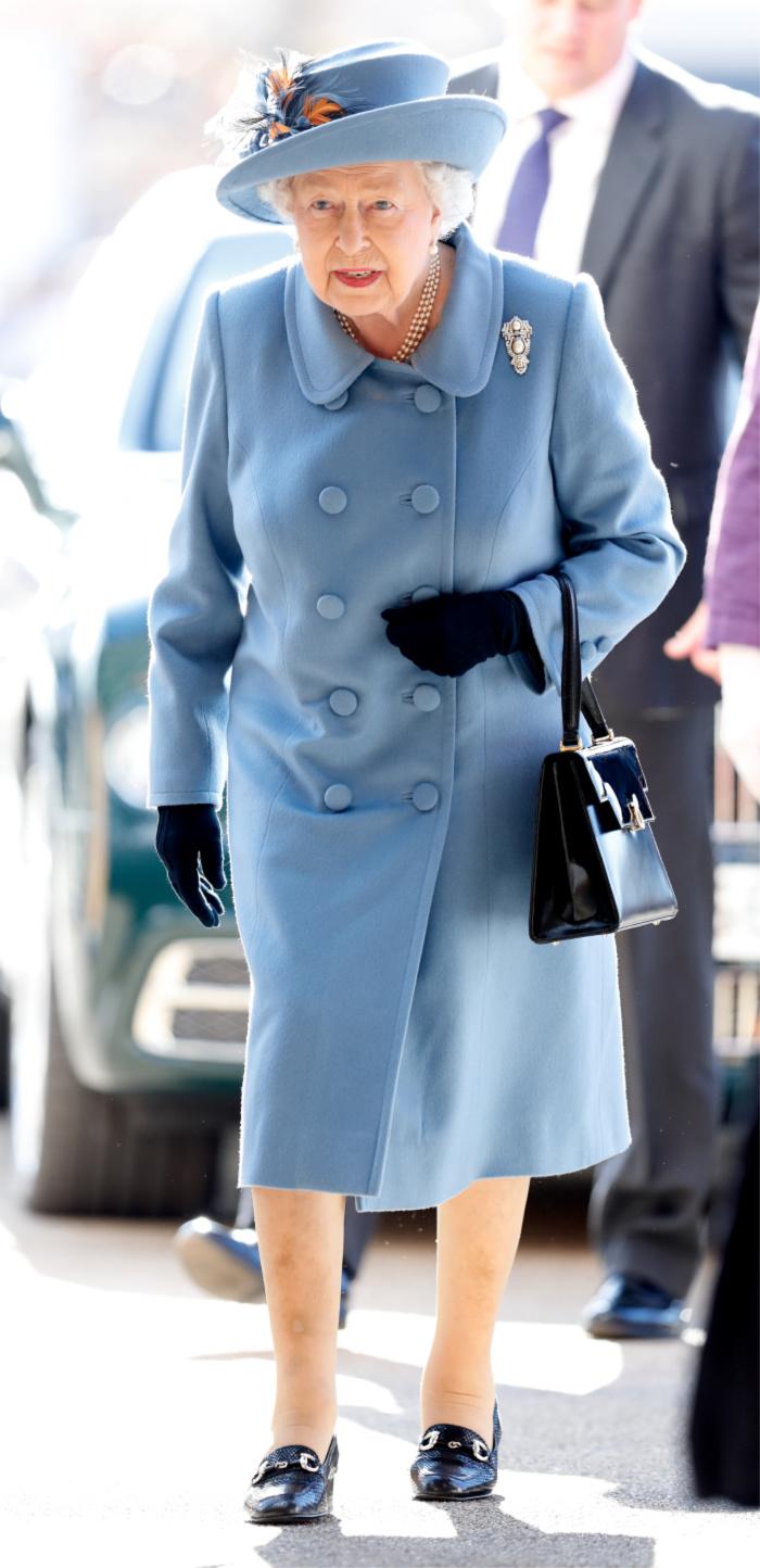 Queen Elizabeth II looked beautiful in a light blue coat.