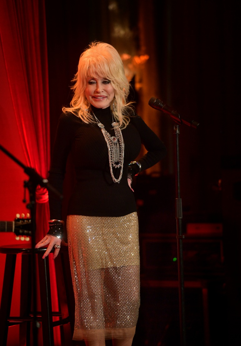 Dolly Parton put on a stunning display in gold as she performed at a luncheon in Los Angeles for the Netflix filmDumplin'. Source: Getty