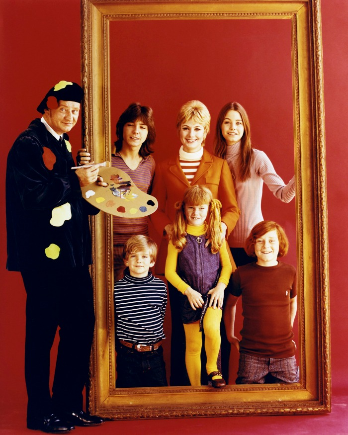 Clockwise, from left: Dave Madden, David Cassidy, Shirley Jones, Susan Dey, Danny Bonaduce, Suzanne Crough and Brian Forster. Source: Getty.