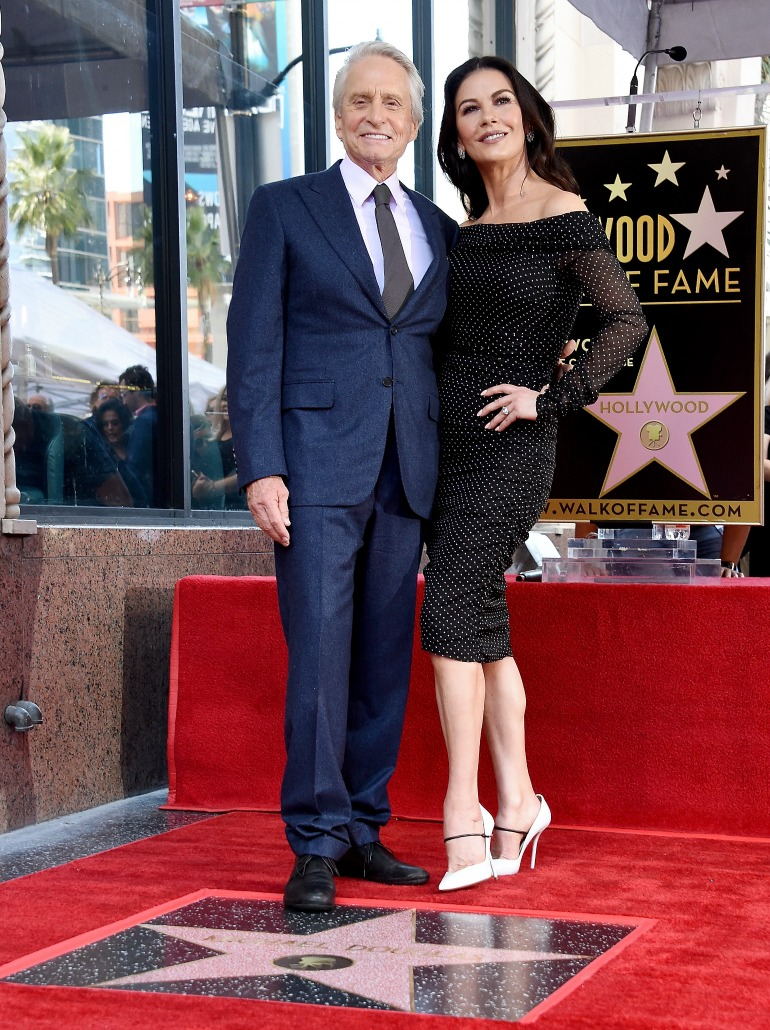 Michael Douglas and Catherine Zeta-Jones pose at the Hollywood Walk of Fame. Source: Getty