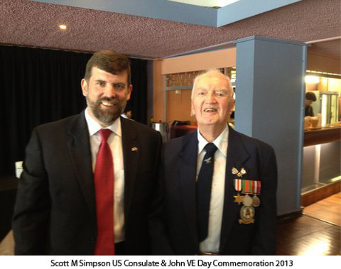 Scott M Simpson of the US Consulate meets with World War II veteran John Briggs on Victory in Europe Day in 2013.
