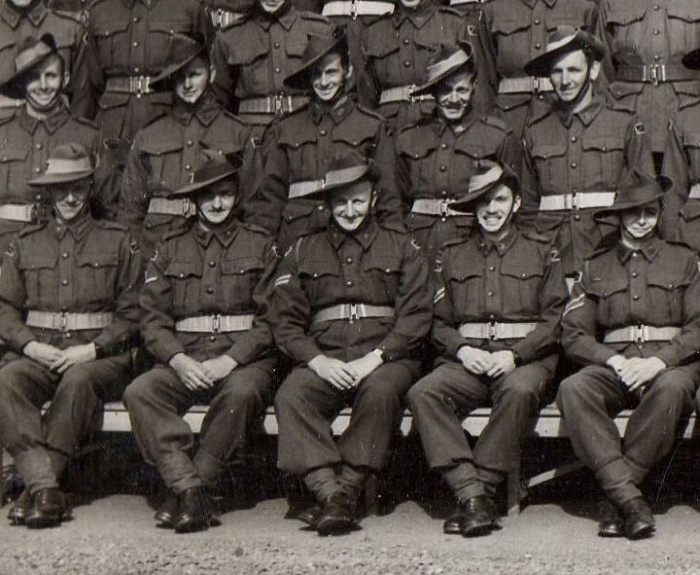 Alan Robinson (front row, second on the right) sits with the anti aircraft battalion in 1942.