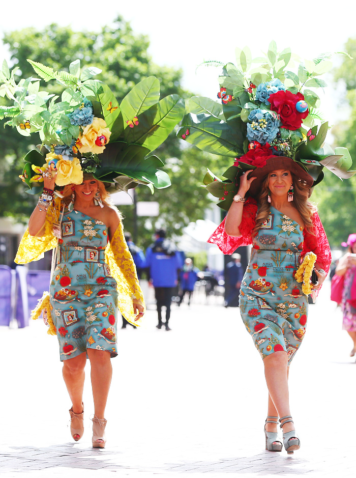 A couple of racegoers had a bit of fun with some exuberant flower hats on Oaks Day.