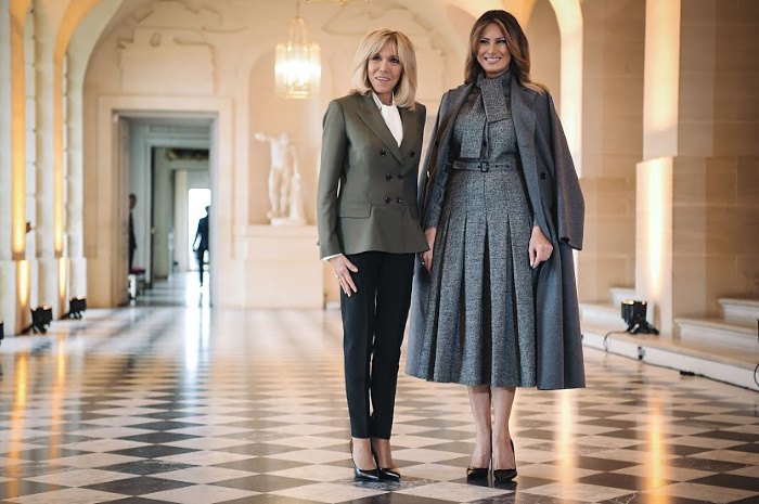 The French President's wife and US First Lady Melania Trump pose during an event at the Chateau de Versailles in Paris as part of commemorations marking the 100th anniversary of the end of World War I.
