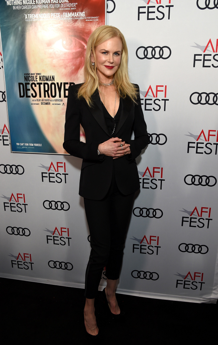 Nicole Kidman looked gorgeous as she posed for photos in a simple black suit for the screening of her latest film Destroyer, in Los Angeles.