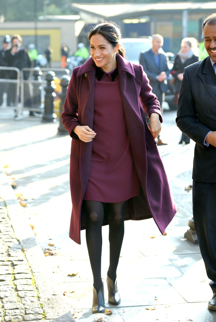 Meghan looked glam in a short burgundy dress. Source: Getty.