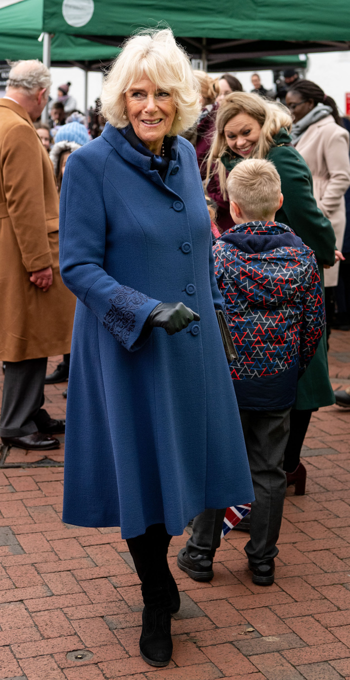 The Duchess of Cornwall was spotted wearing a long blue coat and black boots for an official engagement with husband Prince Charles.