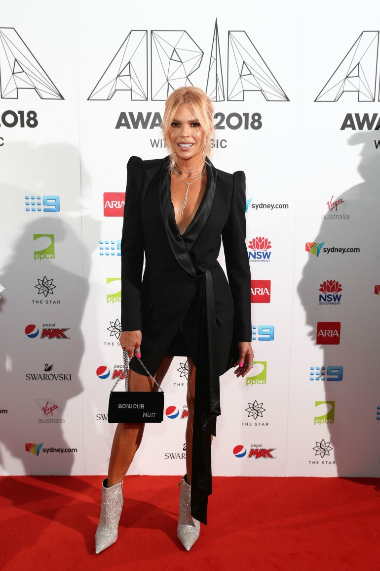 Sonia Kruger stunned in a stylish tuxedo-inspired mini dress. Source: Getty
