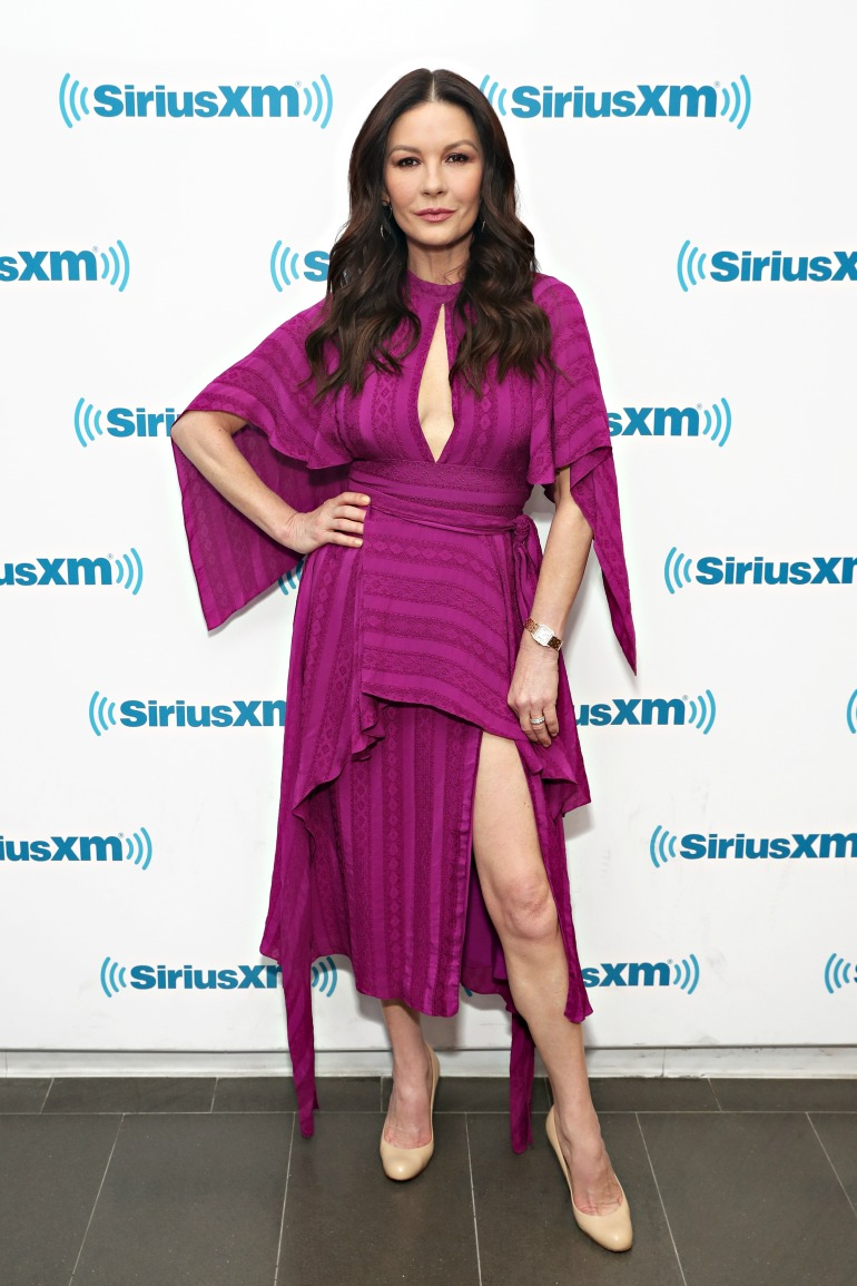 Catherine Zeta-Jones put on a striking display in fuchsia as she made an appearance at radio station SiriusXM in New York City on Thursday. Source: Getty